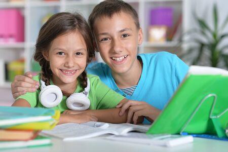 Portrait of brother and sister doing homework together 版權商用圖片