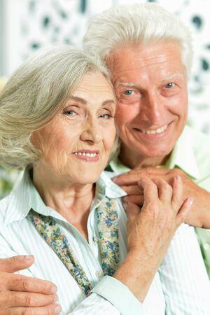 Close up portrait of happy senior couple posing Banco de Imagens