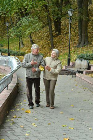 Portrait of happy senior couple in autumn park Reklamní fotografie