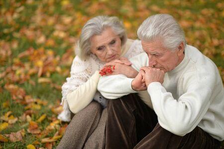 Portrait of senior couple in autumn park