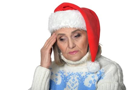 Sad senior woman in Santa hat isolated on white background