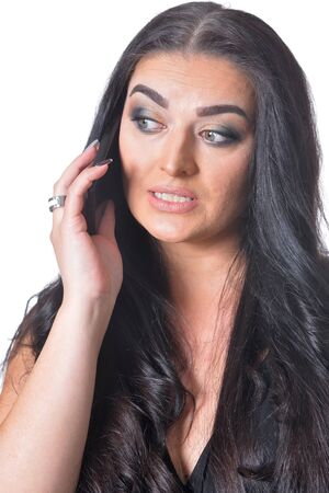 Portrait of cute brunette woman posing against white background