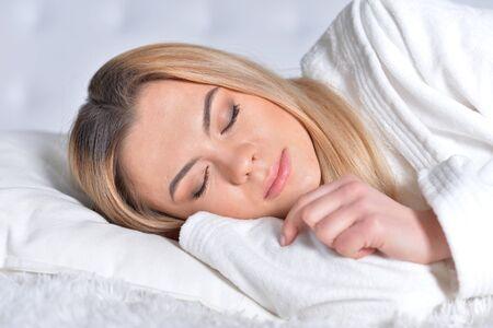 Portrait of beautiful blonde girl sleeping in bed Stok Fotoğraf