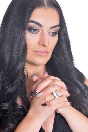 Portrait of cute brunette woman posing against white