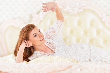 Close up portrait of beautiful young woman on bed