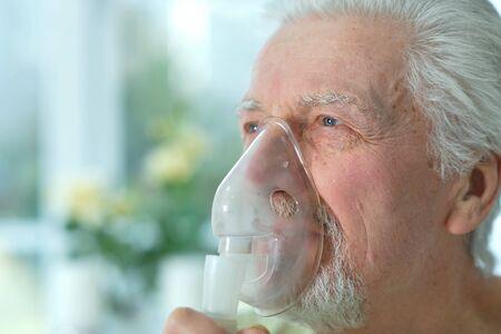 Close up portrait of ill senior man portrait with inhaler Stok Fotoğraf