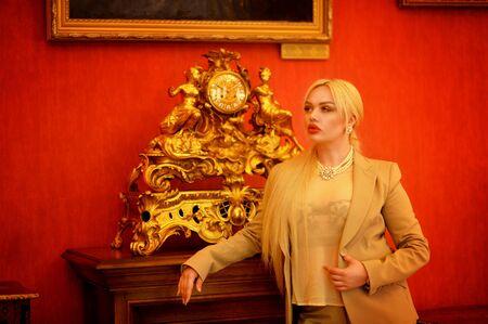 Portrait of a beautiful woman posing by clock Banco de Imagens