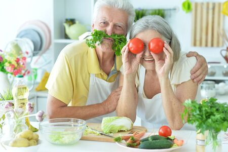 Portrait of a senior couple cooking together at kitchen