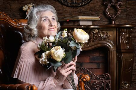 Portrait of woman at home with flowers