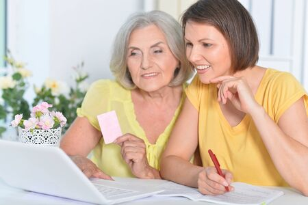 Close up portrait of women showing card shopping online