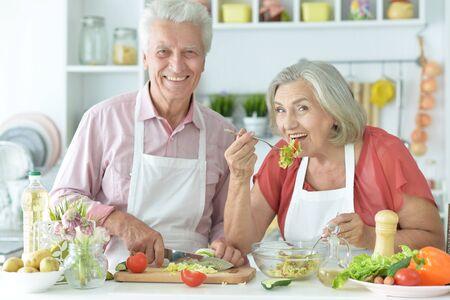 Close up portrait of senior couple cooking