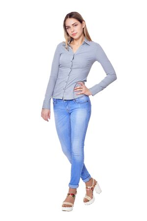 beautiful woman in jeans posing on white