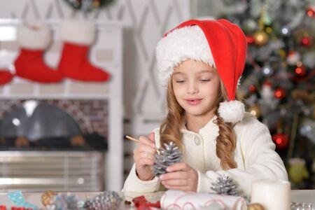 Portrait of little girl in Santa hat