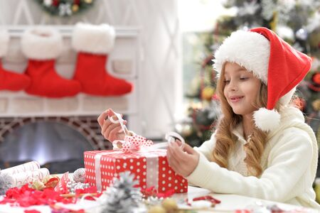 Portrait of little girl with het present