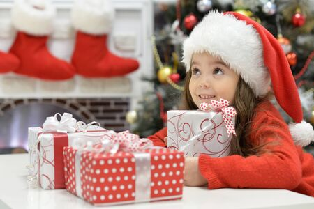 Close up portrait of girl with Christmas presents