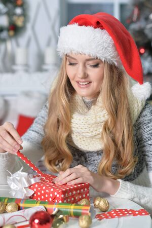 Close up portrait of young woman preparing for Christmas