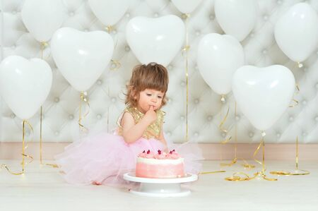 baby girl with cake on her birthday