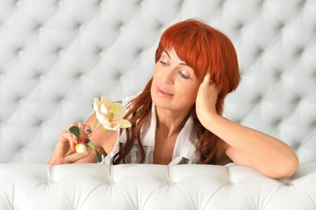 Portrait of beautiful redhead mature woman posing