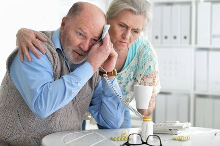 Portrait of sick senior couple calling to doctor Reklamní fotografie