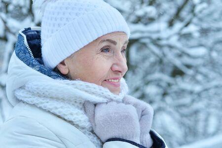 Happy beautiful senior woman in warm hat