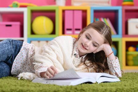 Close up portrait of cute happy girl studying at home Stock Photo