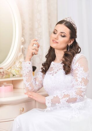 young beautiful bride in white dress posing