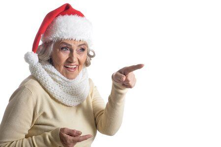 Portrait of happy senior woman in Santa hat Stock Photo