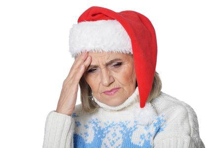Portrait of sad senior woman in Santa hat