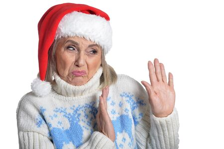 Senior woman with her hands signaling to stop