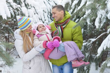 Happy family at beautiful sunny winter day outdoor in nature Stock Photo - 136988005