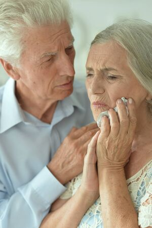 Close up portrait of sick elderly woman and man at home Archivio Fotografico