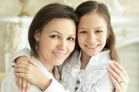 Beautiful young mother and cute little daughter posing Stock Photo - 136936782