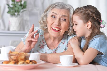 Portrait of old woman with a young girl Stock Photo - 137357997