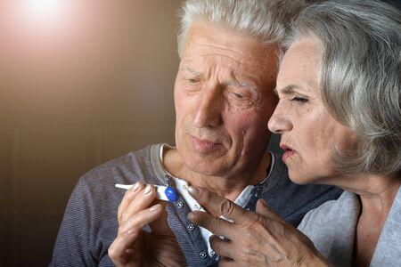 Close up portrait of ill senior couple portrait
