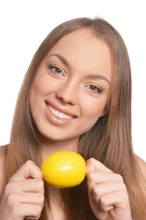 Portrait of beautiful young woman with lemon