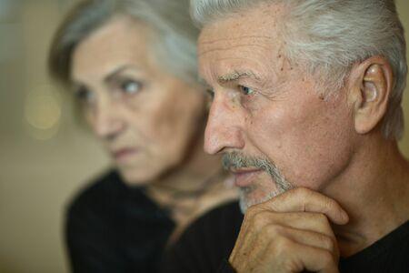 Portrait of sad senior couple posing at home Zdjęcie Seryjne