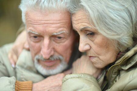 Portrait of sad thoughtful senior couple in park Фото со стока
