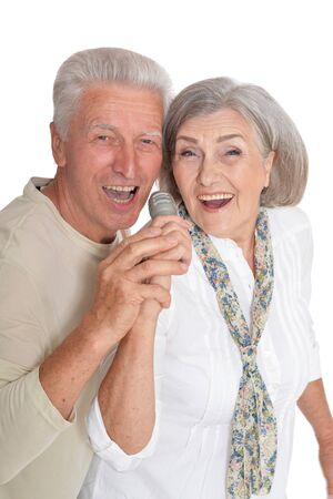 Close up portrait of senior couple with microphone