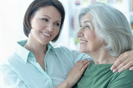 Close up portrait of senior woman with daughter at home Archivio Fotografico