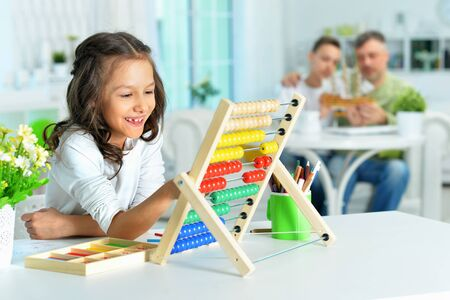 Cute little girl learning to use abacus