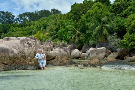Portrait of happy elderly couple rest at tropical beach