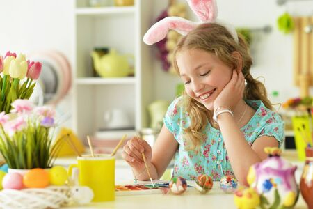 Little beautiful girl is preparing for Easter