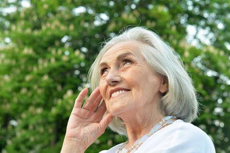 Close up portrait of senior beautiful smiling woman