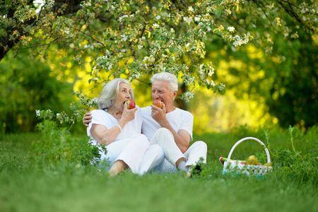 Close up portrait of happy senior couple having picnic
