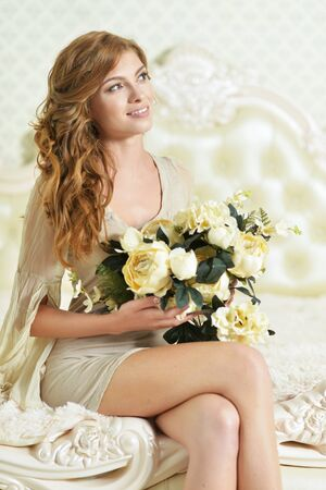 Portrait of beautiful young woman posing with flowers 免版税图像