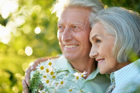 Close up portrait of beautiful senior couple in the park