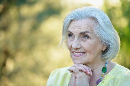 Close up portrait of happy smiling senior beautiful woman