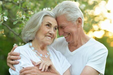 Portrait of beautiful senior couple hugging in the park Reklamní fotografie - 140988233