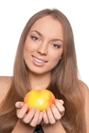 Portrait of beautiful young woman with ripe apple