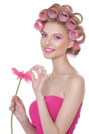 Portrait of beautiful woman with hair curlers